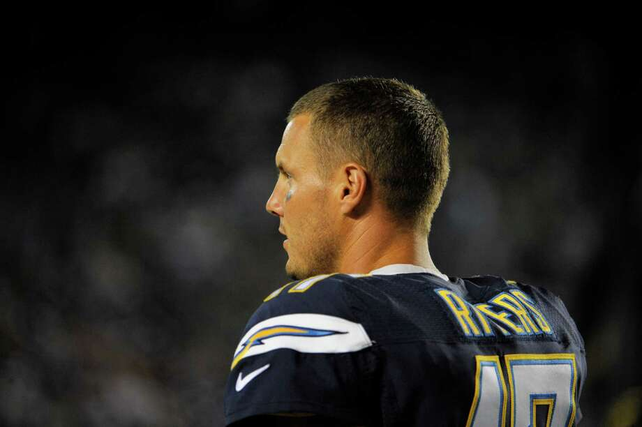 Chargers quarterback Philip Rivers has been around long enough to own a front-row seat to the good times (which ended prematurely in the playoffs) and the bad. Photo: Denis Poroy, FRE / FR59680 AP