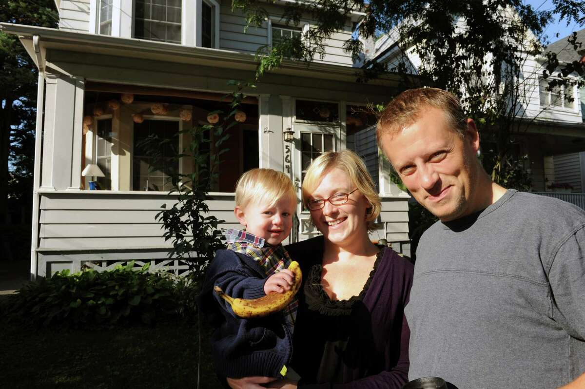 Martin Daley, right, with his wife Jennifer Ceponis and their son Mason Daley in front of their home on Saturday Sept. 7, 2013 in Albany, N.Y. (Michael P. Farrell/Times Union)