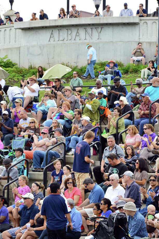 Concert goers applaud during the Albany Riverfront Jazz Festival at the Corning Preserve Saturday, Sept. 7, 2013, in Albany, NY.  (John Carl D'Annibale / Times Union) Photo: John Carl D'Annibale / 00023696A