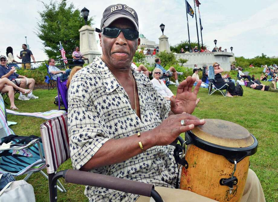 Jeffrey Bryan of Cape Cop plays his West African djimba in between bands at the Albany Riverfront Jazz Festival at the Corning Preserve Saturday, Sept. 7, 2013, in Albany, NY.  (John Carl D'Annibale / Times Union) Photo: John Carl D'Annibale / 00023696A