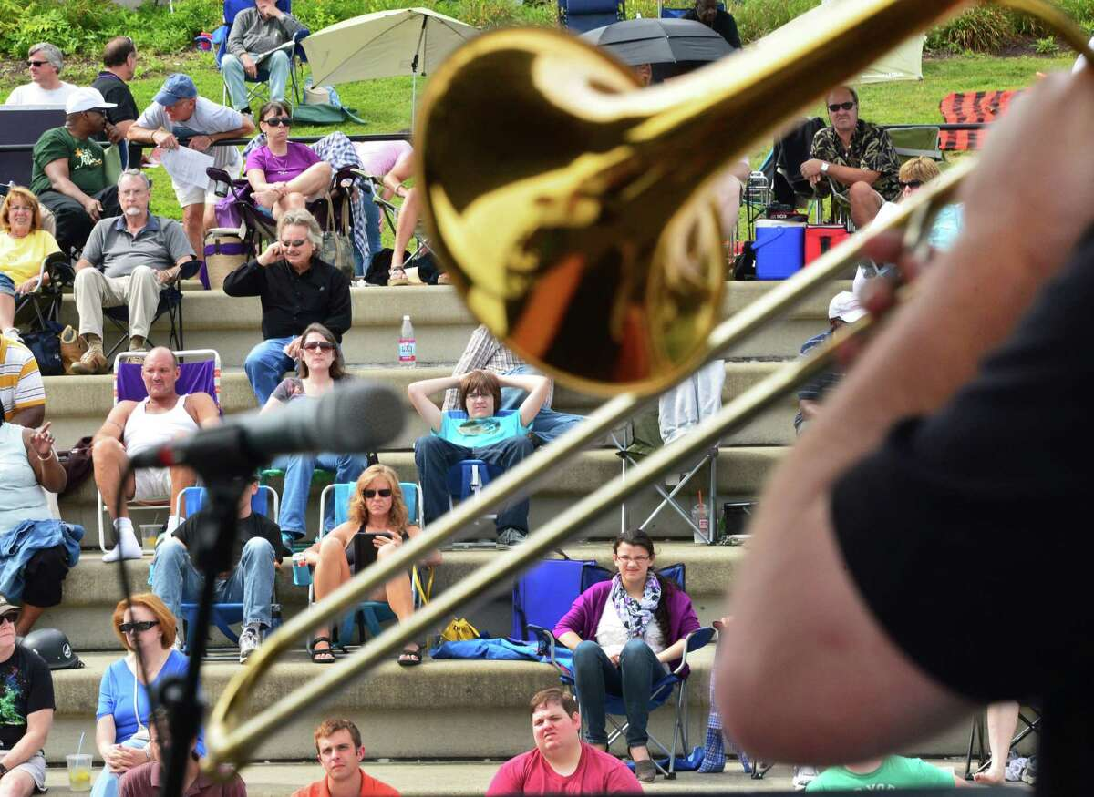 Ben O'Shea plays a trombone solo as the local band Sensemaya performs at the Albany Riverfront Jazz Festival at the Corning Preserve Saturday, Sept. 7, 2013, in Albany, NY. (John Carl D'Annibale / Times Union)