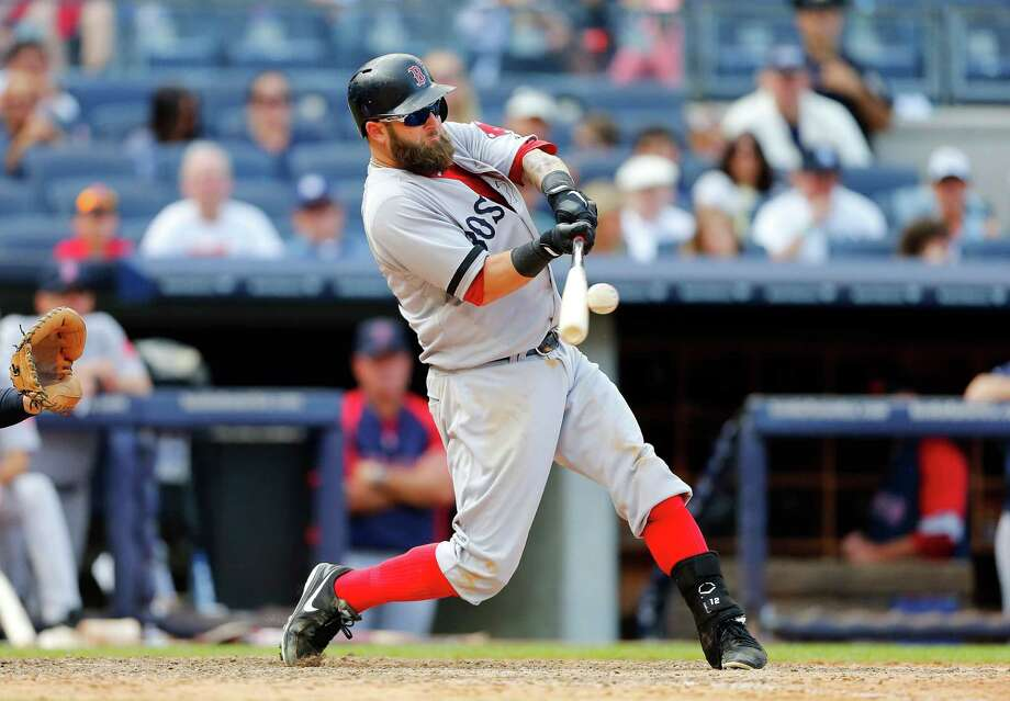 NEW YORK, NY - SEPTEMBER 07:  Mike Napoli #12 of the Boston Red Sox connects on a ninth inning home run against the New York Yankees at Yankee Stadium on September 7, 2013 in the Bronx borough of New York City. Photo: Jim McIsaac, Getty Images / 2013 Getty Images