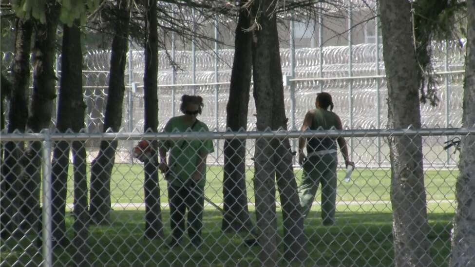 Female prisoners work outside Albion Correctional Facility, a medium security prison for women in Orleans County, New York. (Alysia Santo / Times Union)