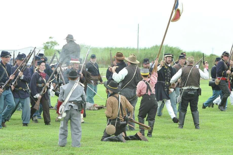 The annual Dick Dowling Days, hosted by the Texas Historical Commission, and held at the Sabine Pass historic battleground in Sabine Pass, saw some 300 plus re-enactors taking part this weekend in re-creating the Battle of Sabine Pass, which took place 150 years ago.  It is a two day event and the public is invited to walk through life as it was in1863, see period camps, history exhibits, witness battle reenactments with live canon fire, and cavalry charges. Dave Ryan/The Enterprise Photo: Dave Ryan