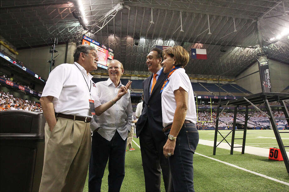 UTSA President Ricardo Romo (from left), Bexar County Judge Nelson Wolff, former city mayor Henry Cisneros and City Manager Sheryl Sculley chat before the UTSA football game against Oklahoma State at the Alamodome on Saturday, Sept. 7, 2013. Photo: Kin Man Hui, San Antonio Express-News / ©2013 San Antonio Express-News