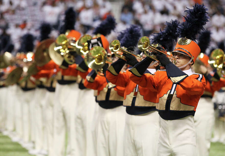 The UTSA Marching Band performs before the game against Oklahoma State in the first half at the Alamodome on Saturday, Sept. 7, 2013. Photo: Kin Man Hui, San Antonio Express-News / ©2013 San Antonio Express-News