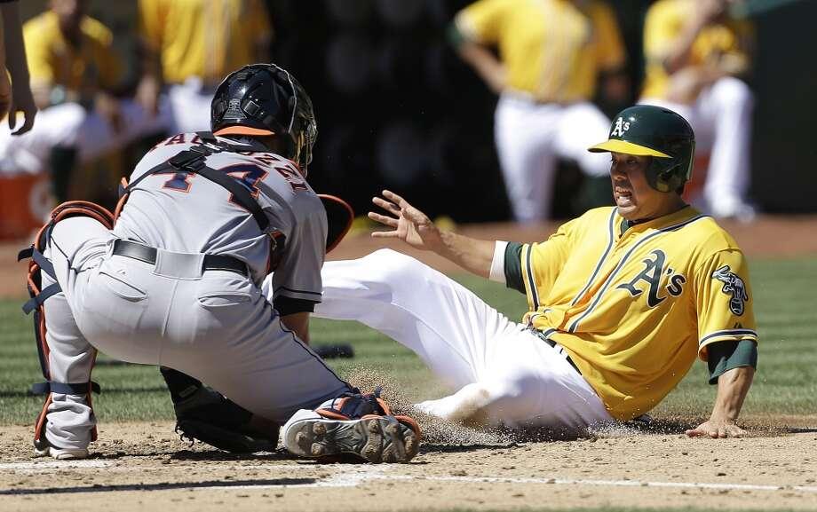 Sept. 7: A's 2, Astros 1  Astros catcher Matt Pagnozzi tags out Kurt Suzuki of the A's. Photo: Jeff Chiu, Associated Press