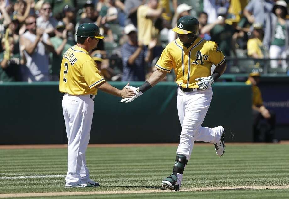 Yoenis Cespedes of the A's is congratulated after hitting a home run against the Astros. Photo: Jeff Chiu, Associated Press