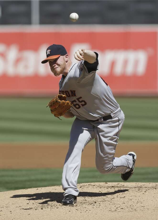 Astros pitcher Brett Oberholtzer delivers a throw to the A's. Photo: Jeff Chiu, Associated Press