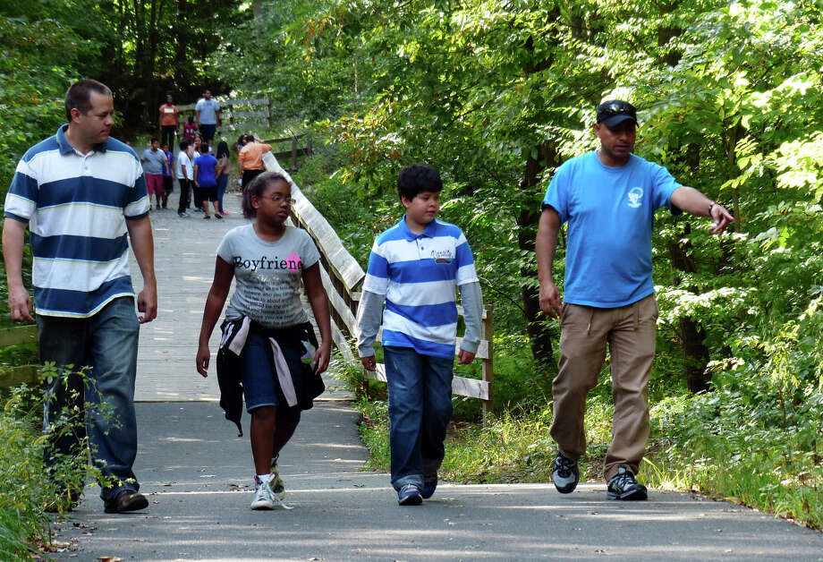 Members of the Pathfinders Club out of Spanish Orion Seventh-day Adventist Church in Bridgeport take a nature hike at Old Mine Park in Trumbull, Conn. on Saturday September 7, 2013. The Pathfinders Club is an international club for youth sponsored by the Seventh-day Adventist Church and in Connecticut, Massachussetts, and Rhode Island there are 45 clubs with over 1200 members. There were about 30 kids who came to the park and broke up into small groups with other instructors to learn about nature, the environment, good stewardship of it, and other topics with a spiritual theme. For more information about the Pathfinders organization: http://www.pathfindersonline.org/ Photo: Christian Abraham / Connecticut Post