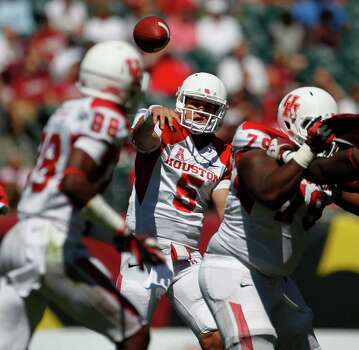 Houston Cougars quarterback John O'Korn (5) makes a pass in the third quarter to Houston Cougars wide receiver Xavier Maxwell (88) as the University of Houston Cougars defeated the Temple Owls 22-13 in their first American Athletic Conference game at Lincoln Financial Field Saturday, Sept. 7, 2013, in Philadelphia. Photo: Johnny Hanson, Houston Chronicle / © 2013  Houston Chronicle