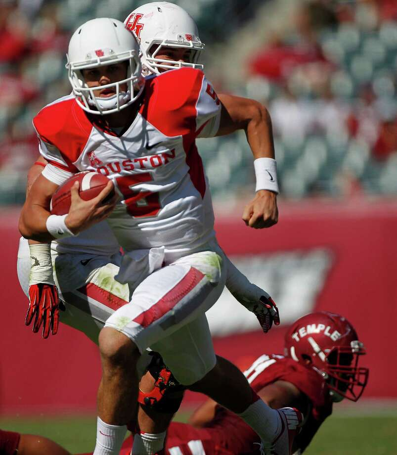 Houston Cougars quarterback John O'Korn (5) runs with the ball in the fourth quarter as the University of Houston Cougars defeated the Temple Owls 22-13 in their first American Athletic Conference game at Lincoln Financial Field Saturday, Sept. 7, 2013, in Philadelphia. Photo: Johnny Hanson, Houston Chronicle / © 2013  Houston Chronicle