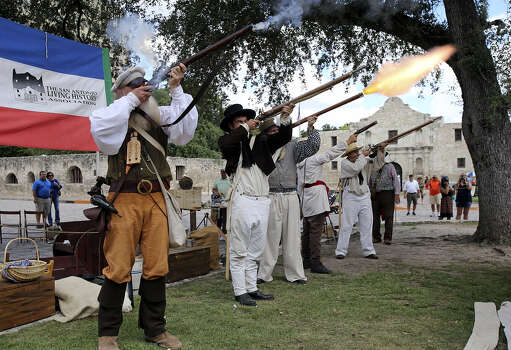Members of the San Antonio Living History Association fire off a volley in front of the Alamo at the Save Texas History symposium. The daylong event drew about 250 people. Photo: Tom Reel / San Antonio Express-News