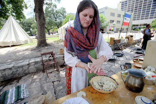 Amanda Maloney, with the San Antonio Living History Association,  makes corn tortillas in Alamo Plaza as the Save Texas History symposium is hosted by theTexas General Land Office on September 7,  2013. Photo: For The San Antonio Express-News