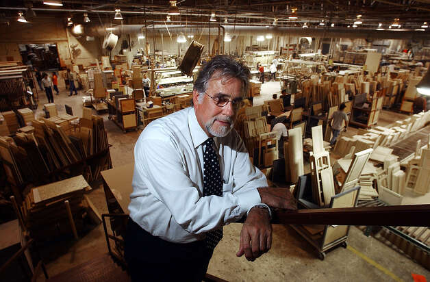 BUSINESS - Cardell Cabinetry president Bill Tidwell stands ...