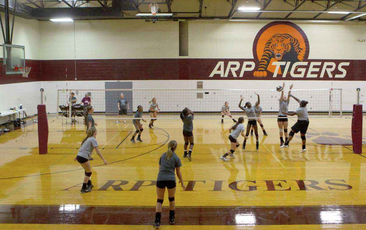 The Guy V. Lewis Gymnasium hosts practice for the Arp High School volleyball team while serving as a testament to what the town's residents can achieve.