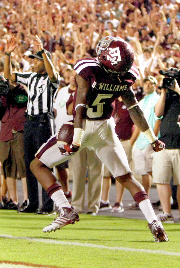 Texas A&M Aggies running back Brandon Williams celebrates after scoring a touchdown during the third quarter against the Sam Houston State Bearkats at Kyle Field Saturday, Sept. 7, 2013, in College Station. Photo: Cody Duty, Houston Chronicle / © 2013 Houston Chronicle
