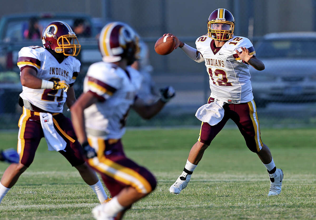 Quarterback Brandon Ramon spots an Indian receiver as Lanier plays Harlandale at SAISD Spring Sports Complex on September 7, 2013.