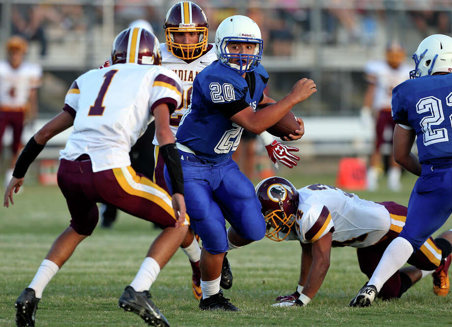 Vok running back Joe Orta tries to escape a trap as Lanier plays Harlandale at SAISD Spring Sports Complex on September 7,  2013. Photo: TOM REEL