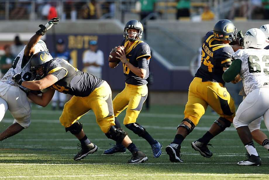 "Cal's Jared Goff (center) passed for 485 yards and two touchdowns in his second college game, but said his play was ""not very good. I wasn't very happy with it. There's a lot of stuff we need to work on."" Photo: Michael Short, The Chronicle"
