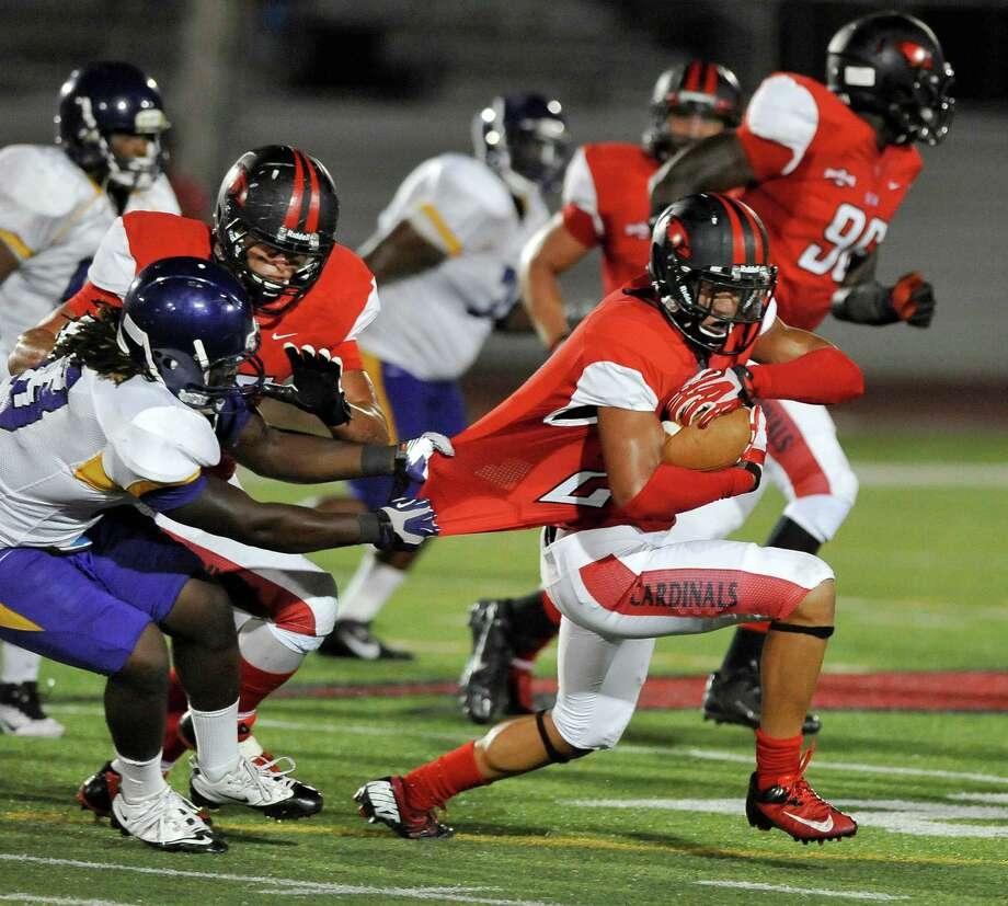 Incarnate Word defensive back Kielyn Lewis, right, makes an interception during the first half of a college football game against Texas College, Saturday, Sept. 7, 2013, at the University of the Incarnate Word in San Antonio. (Darren Abate/For the Express-News) Photo: Darren Abate, Darren Abate/Express-News