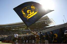 A flag is waved after Cal scored a touchdown in the second quarter as the California Golden Bears play the Portland State Vikings at Memorial Stadium in Berkeley, CA Saturday September 7, 2013.