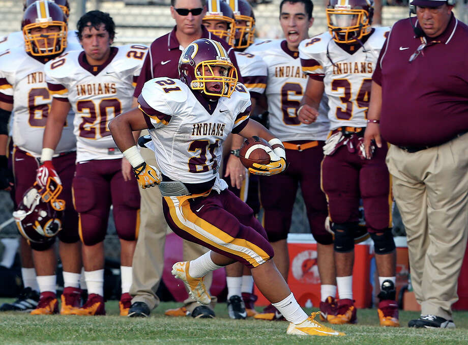 Running back Nicholas Martinez sprints down the left sideline for the Indians as Lanier plays Harlandale at SAISD Spring Sports Complex on September 7,  2013. Photo: TOM REEL