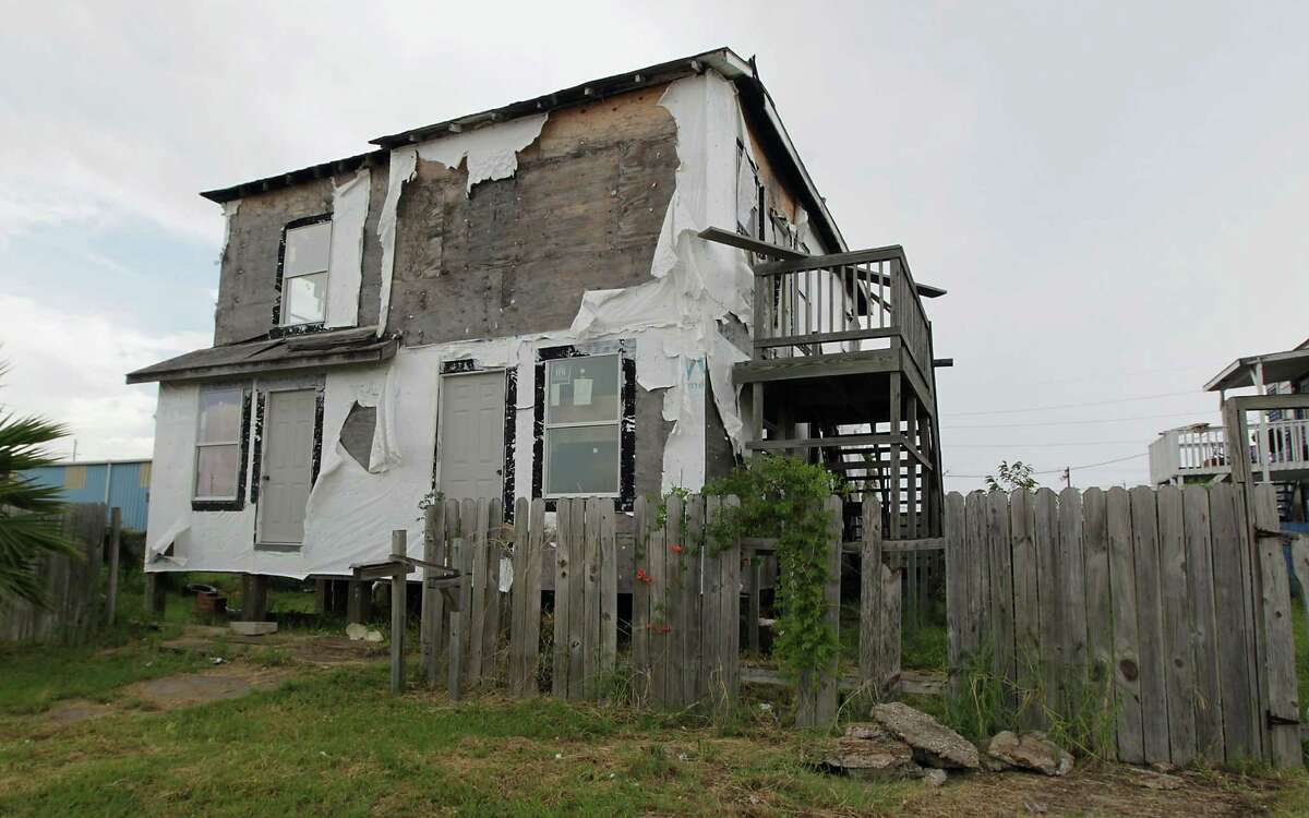 Five years after Hurricane Ike a home on Bayou Shore Drive sits vacant in need of repair Wednesday, Sept. 4, 2013, in Galveston. ( James Nielsen / Houston Chronicle )