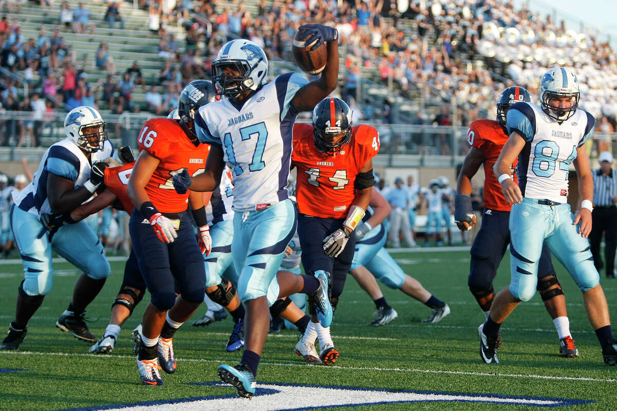 Johnson running back Braedon Williams (17) scores a touchdown during the first quarter of their game with Brandeis at Farris Stadium on Saturday, Sept. 7, 2013. MARVIN PFEIFFER/ mpfeiffer@express-news.net