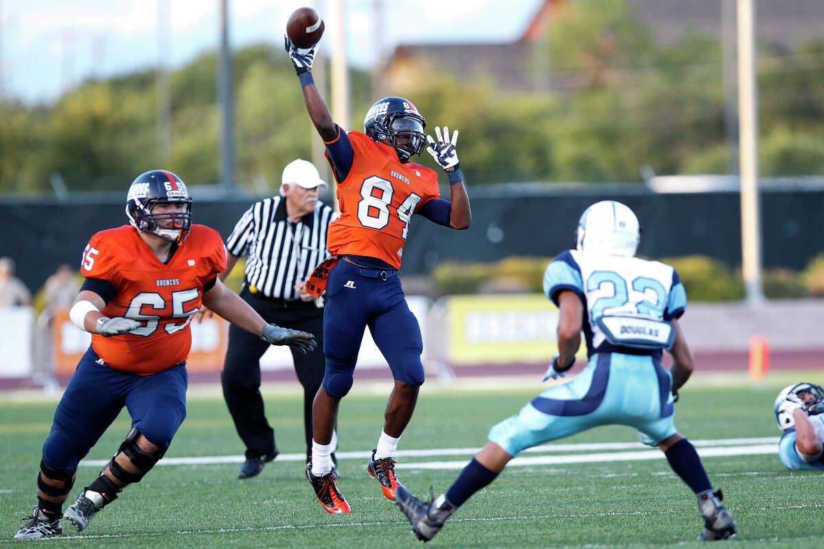 Brandeis wide receiver Larry Stephens (84) throws a touchdown pass to Peyton Hall during the second quarter of their game with Johnson at Farris Stadium on Saturday, Sept. 7, 2013. Brandeis beat the Broncos 68-53. MARVIN PFEIFFER/ mpfeiffer@express-news.net