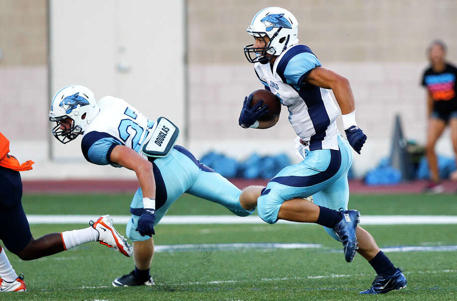 Johnson wide receiver Josh Theissen scores on a 73-yard touchdown reception during the first quarter of their game with Brandeis at Farris Stadium on Saturday, Sept. 7, 2013. Theissen had 328 yards receiving in the game to set a city record.   MARVIN PFEIFFER/ mpfeiffer@express-news.net Photo: MARVIN PFEIFFER, Marvin Pfeiffer/ Express-News / Express-News 2013