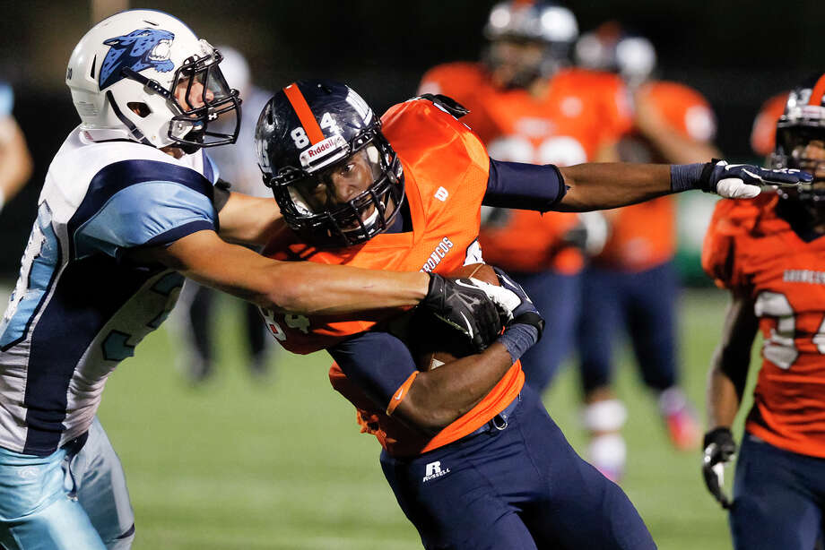 Brandeis wide receiver Larry Stephens (right) tries to break free from Johnson's Kyle Hrncir during the third quarter of their game at Farris Stadium on Saturday, Sept. 7, 2013.  Brandeis beat the Jaguars 68-53.  MARVIN PFEIFFER/ mpfeiffer@express-news.net Photo: MARVIN PFEIFFER, Marvin Pfeiffer/ Express-News / Express-News 2013