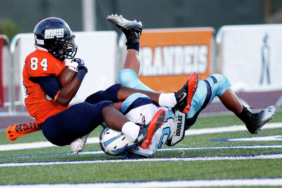 Brandeis's Larry Stephens (left) comes down with a touchdown in the end zone despite the efforts of Johnson's R.J. Espinoza during the second quarter of their game at Farris Stadium on Saturday, Sept. 7, 2013.  Brandeis beat the Jaguars 68-53.  MARVIN PFEIFFER/ mpfeiffer@express-news.net Photo: MARVIN PFEIFFER, Marvin Pfeiffer/ Express-News / Express-News 2013