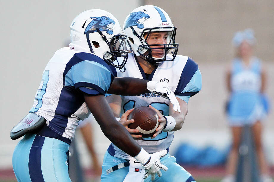 Johnson quarterback Hunter Rittimann (right) hands off to running back Deon Jones during the second quarter of their game with Brandeis at Farris Stadium on Saturday, Sept. 7, 2013.  MARVIN PFEIFFER/ mpfeiffer@express-news.net Photo: MARVIN PFEIFFER, Marvin Pfeiffer/ Express-News / Express-News 2013