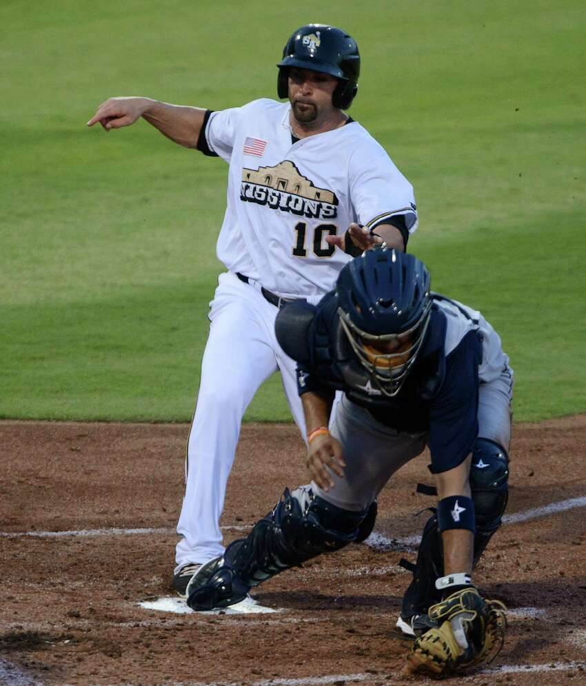 Jake Blackwood of the San Antonio Missions is forced out at home by Corpus Christi catcher Carlos Corporan in the second inning of Texas League playoffs action at Wolff Stadium on Saturday, Sept. 7, 2013.