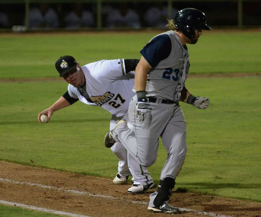 San Antonio Missions pitcher Jeremy McBryde throws the ball into Corpus Christi runner Jonathan Meyer during Texas League playoffs action at Wolff Stadium on Saturday, Sept. 7, 2013. Meyer was safe on the play and McBryde was charged with an error.