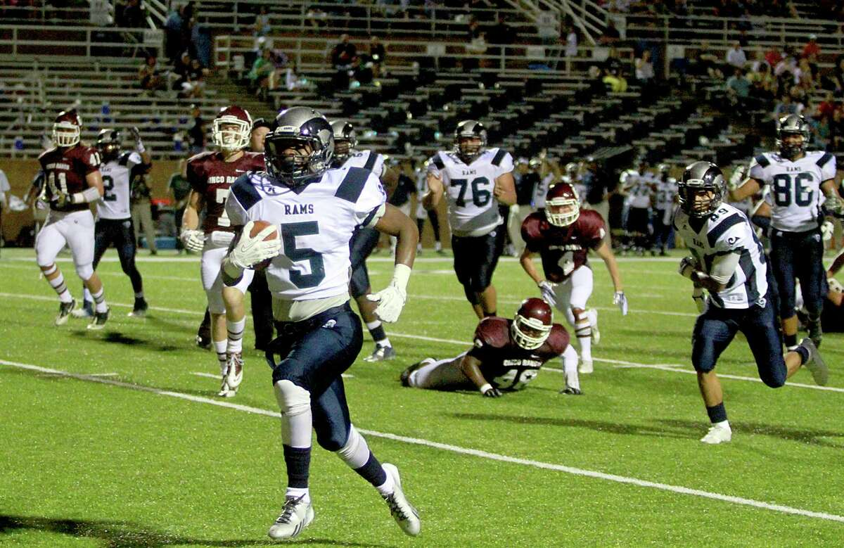 Cinco Ranch 49, Cy Ridge 26 9/7/13: Cy Ridge Ram Anthony Williams #5 rushes for a 16 yard touchdown against the Cinco Ranch Cougars at Rhodes Stadium in Katy, Texas.