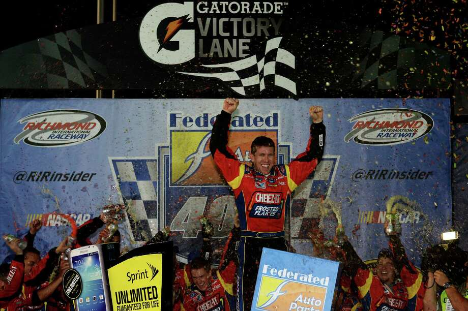 RICHMOND, VA - SEPTEMBER 07:  Carl Edwards, driver of the #99 Kellogg's / Cheez-It Ford, celebrates in Victory Lane after winning the NASCAR Sprint Cup Series 56th Annual Federated Auto Parts 400 at Richmond International Raceway on September 7, 2013 in Richmond, Virginia.  (Photo by Patrick Smith/Getty Images) ORG XMIT: 159337536 Photo: Patrick Smith / 2013 Getty Images