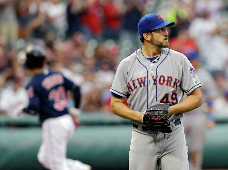 New York Mets starting pitcher Jonathon Niese (49) looks away after giving up a solo home run to Cleveland Indians' Nick Swisher in the second inning of a baseball game Saturday, Sept. 7, 2013, in Cleveland. (AP Photo/Mark Duncan) ORG XMIT: CDB110 Photo: Mark Duncan / AP