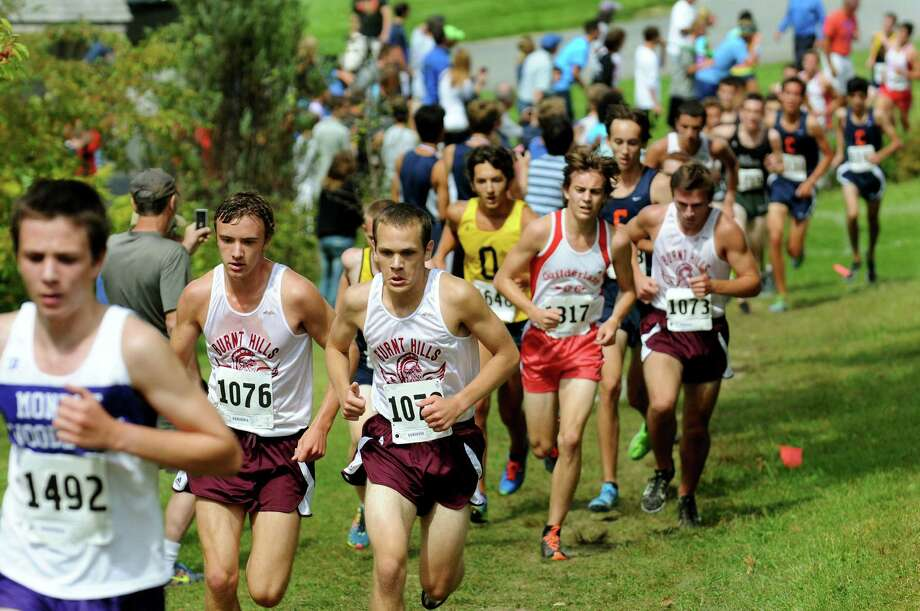 Boys varsity runs in the Guilderland Invitational Cross Country meet on Saturday, Sept. 7, 2013, at Tawasentha Park in Guilderland, N.Y. (Cindy Schultz / Times Union) Photo: Cindy Schultz / 00023734A