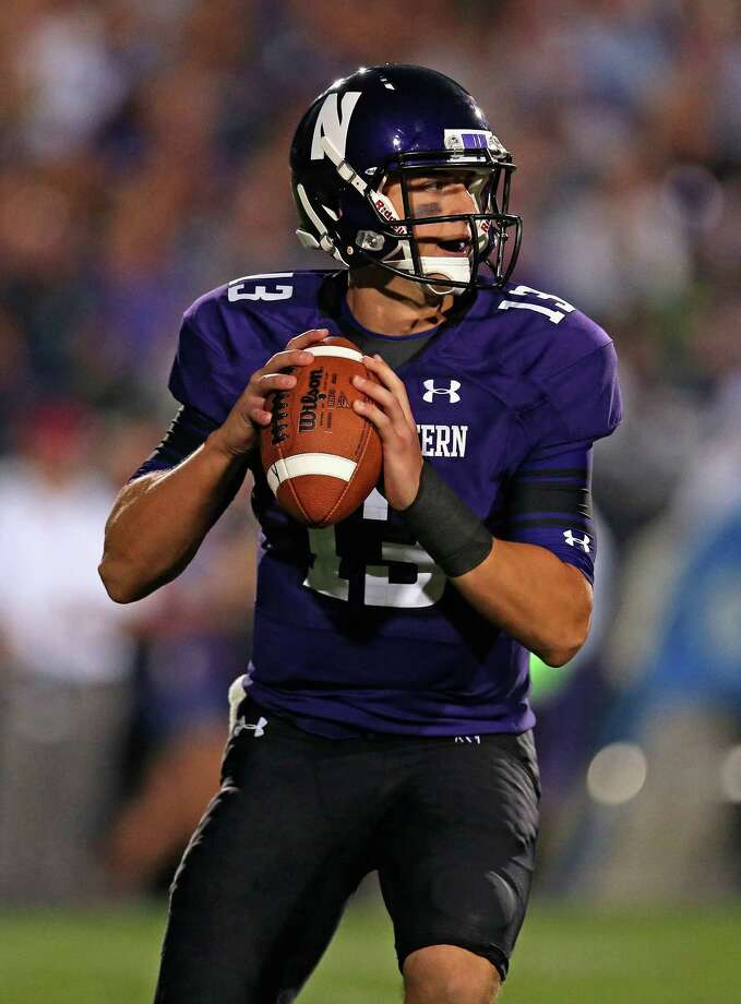 EVANSTON, IL - SEPTEMBER 07: Tervor Siemian #13 of the Northwestern Wildcats looks for a receiver against the Syracuse Orange at Ryan Field on September 7, 2013 in Evanston, Illinois. Northwestern defeated Syracuse 48-27. (Photo by Jonathan Daniel/Getty Images) ORG XMIT: 176403356 Photo: Jonathan Daniel / 2013 Getty Images