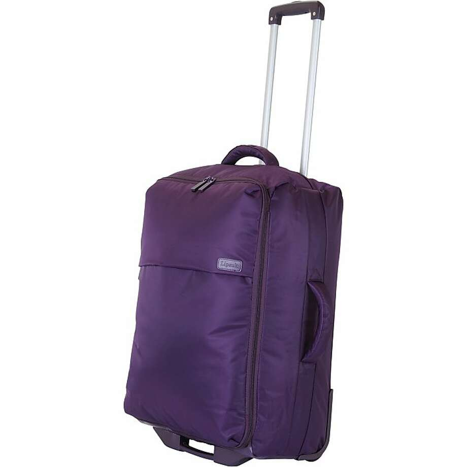 "Lipault Paris 26"" 2-Wheeled Foldable Packing Case folds into its own little 4-inch case for quick and convenient storage under a bed or in a closet. Photo: Lipault Paris"