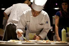 Seong Jun Ahn, a student at CIA, makes fish tacos for Jole during the Appellation Trail Tasting, a Flavor! Napa Valley event, at The Culinary Institute of America at Greystone in St. Helena, Calif., Friday, November 16, 2012.