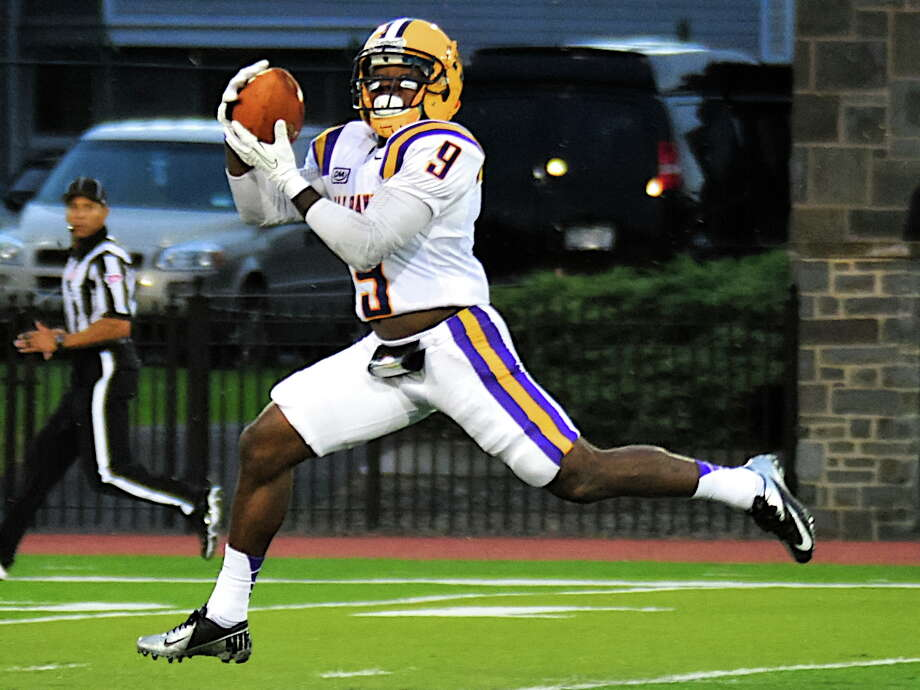UAlbany?s Kevin Chillis hauls in a 51-yard touchdown pass from quarterback Will Fiacchi in the second quarter Saturday against Colgate. Bill Ziskin / Special to the Times Union Photo: BILL ZISKIN / BILL ZISKIN