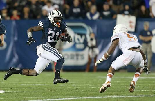 PROVO, UT - SEPTEMBER 7: Jamaal Williams #21 of BYU Cougars looks to run past Josh Turner #5 of the Texas Longhorns during the first half of an NCAA football game September 7, 2013 at LaVell Edwards Stadium in Provo, Utah. Photo: George Frey, Getty Images / 2013 Getty Images