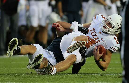 PROVO, UT - SEPTEMBER 7: Alani Fua #5 of BYU Cougars sacks quarterback David Ash #14 of the Texas Longhorns during the first half of an NCAA football game September 7, 2013 at LaVell Edwards Stadium in Provo, Utah. Photo: George Frey, Getty Images / 2013 Getty Images