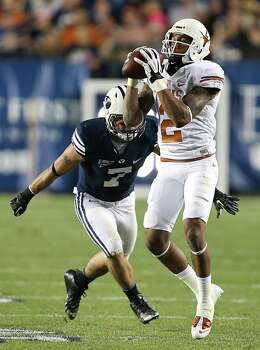 PROVO, UT - SEPTEMBER 7: Skye PoVey #7 of the BYU Cougars zeros in on Kendall Sanders #2 of the Texas Longhorns as he catches a pass during the first half of an NCAA football game September 7, 2013 at LaVell Edwards Stadium in Provo, Utah. Photo: George Frey, Getty Images / 2013 Getty Images