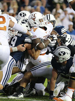 PROVO, UT - SEPTEMBER 7: Joe Bergeron #24 of the Texas Longhorns forces his way in for a touchdown during a game against the BYU Cougars  during the first half of an NCAA football game September 7, 2013 at LaVell Edwards Stadium in Provo, Utah. Photo: George Frey, Getty Images / 2013 Getty Images