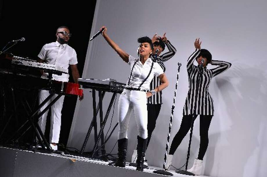 Janelle Monae performs during the Rebecca Minkoff Spring 2014 Runway Show at The Theatre at Lincoln Center on September 6, 2013. Photo: Stephen Lovekin/, Getty