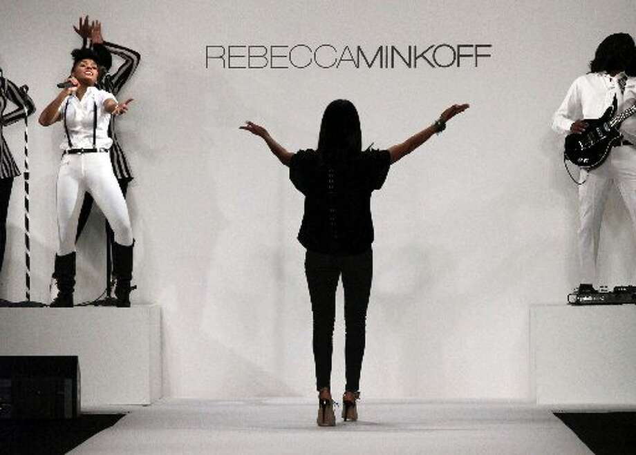 Designer Rebecca Minkoff salutes singer Janelle Monae. Photo: Lisa Tolin, AP